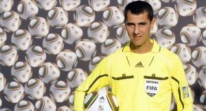 Uzbebistan referee Irmatov at the 2010 World Cup with Jubilani ball.