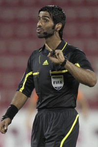 Qatari referee Khamis Al Marri gestures during a Qatar Stars League match.