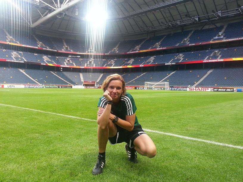 Lucie Ratajova in football stadium.