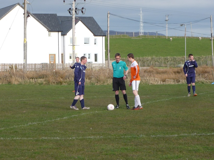 Coin toss during Islay game.