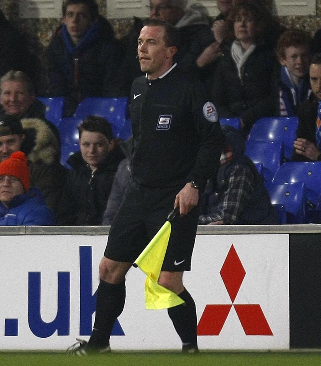 Barry Holderness as assistant referee.
