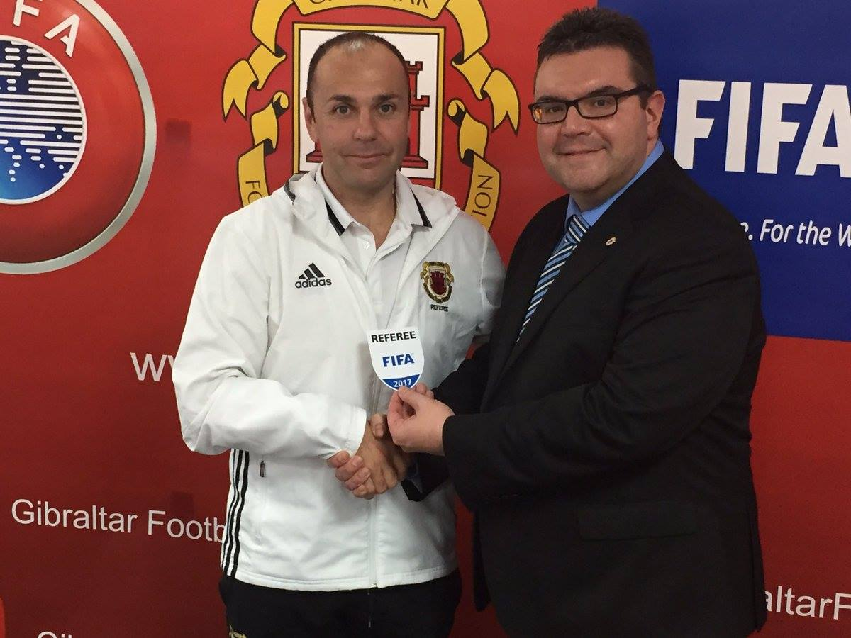 Jason Barcelo receiving his FIFA badge. Photo courtesy of Gibraltar FA