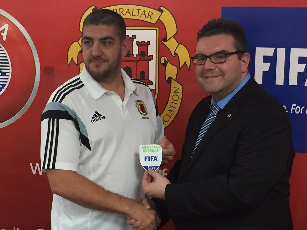 Johan Ward receiving his FIFA badge. Photo courtesy of Gibraltar FA