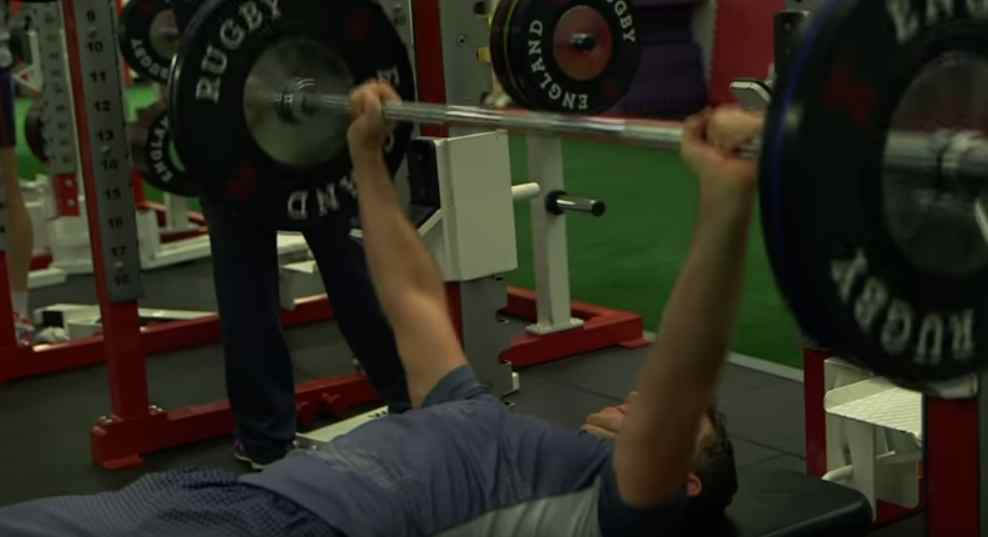 Top flight rugby referee lifting weights.
