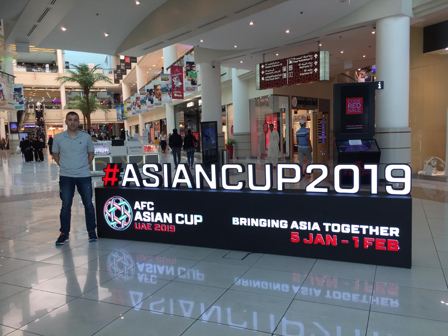 Hakan Anaz with Asian Cup 2019 Logo