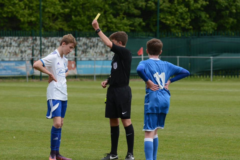 Harvey showing a yellow card