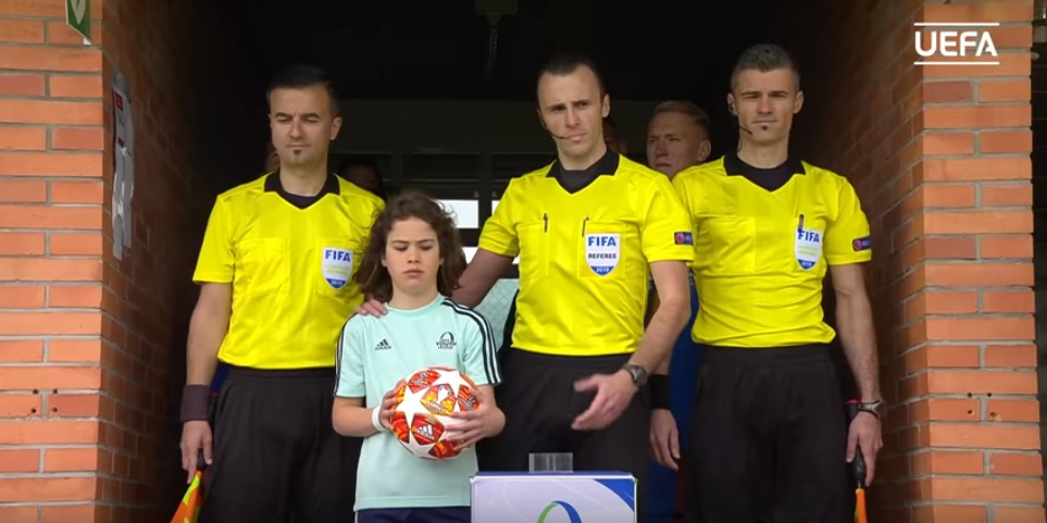 Referee Ivan Peljto (BIH) and his team